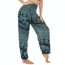 Load image into Gallery viewer, Empower your energy flow during yoga practice with these Hummingbird Ink Washed Elephant Tribal Loose Yoga Pants-Teal Green. Elephants, a symbol of strength, durability and longevity, have important significance in Asian cultures. Featuring ink washed elephants and tribal elements, these loose harem pants are the must-have companion for your yoga journey, be it for asanas, pranayama, or meditation. Handmade with natural dyeing techniques. Perfect for yoga, meditation, dancing or daily wear.