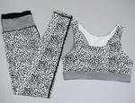 Hummingbird Leopard Print Sports Set containing a racerback top and a pair of cropped leggings, made of breathable and wicking fabric that's comfortable to wear. Perfect for workout and yoga