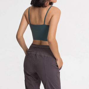 Take your active look from studio to street with this Longline Padded Sports Bra - Deep Teal. Featuring thin straps and 13-15 inch / 33-38 cm shortened length, this fitted crop tank top is ideal for low impact activities, be it for workouts, running errands or lounging. This cute camisole kisses your high waisted pants, and is easy to layer. Perfect for low impact exercise like weight training, yoga, cycling, spinning, dancing and more. Complete the look with our High Waist Hidden Pocket Leggings.