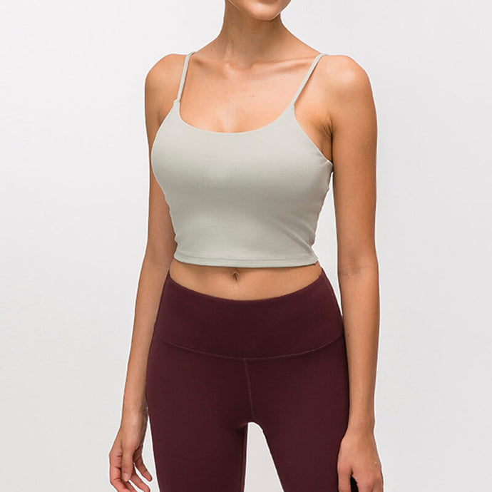 Take your active look from studio to street with this Longline Padded Sports Bra - Jasmine Green. Featuring thin straps and 13-15 inch / 33-38 cm shortened length, this fitted crop tank top is ideal for low impact activities, be it for workouts, running errands or lounging. This cute camisole kisses your high waisted pants, and is easy to layer. Perfect for low impact exercise like weight training, yoga, cycling, spinning, dancing and more. Complete the look with our High Waist Hidden Pocket Leggings.