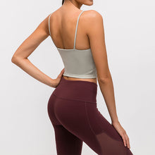 Load image into Gallery viewer, Take your active look from studio to street with this Longline Padded Sports Bra - Jasmine Green. Featuring thin straps and 13-15 inch / 33-38 cm shortened length, this fitted crop tank top is ideal for low impact activities, be it for workouts, running errands or lounging. This cute camisole kisses your high waisted pants, and is easy to layer. Perfect for low impact exercise like weight training, yoga, cycling, spinning, dancing and more. Complete the look with our High Waist Hidden Pocket Leggings.