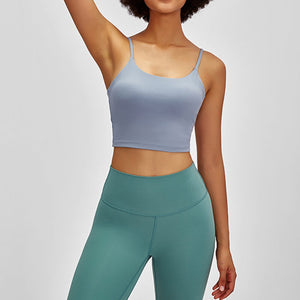 Take your active look from studio to street with this Longline Padded Sports Bra - Light Blue. Featuring thin straps and 13-15 inch / 33-38 cm shortened length, this fitted crop tank top is ideal for low impact activities, be it for workouts, running errands or lounging. This cute camisole kisses your high waisted pants, and is easy to layer. Perfect for low impact exercise like weight training, yoga, cycling, spinning, dancing and more. Complete the look with our High Waist Hidden Pocket Leggings.