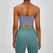 Load image into Gallery viewer, Take your active look from studio to street with this Longline Padded Sports Bra - Light Blue. Featuring thin straps and 13-15 inch / 33-38 cm shortened length, this fitted crop tank top is ideal for low impact activities, be it for workouts, running errands or lounging. This cute camisole kisses your high waisted pants, and is easy to layer. Perfect for low impact exercise like weight training, yoga, cycling, spinning, dancing and more. Complete the look with our High Waist Hidden Pocket Leggings.