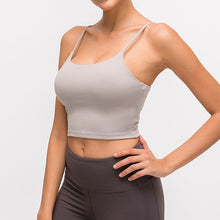 Load image into Gallery viewer, Take your active look from studio to street with this Longline Padded Sports Bra - Light Grey. Featuring thin straps and 13-15 inch / 33-38 cm shortened length, this fitted crop tank top is ideal for low impact activities, be it for workouts, running errands or lounging. This cute camisole kisses your high waisted pants, and is easy to layer. Perfect for low impact exercise like weight training, yoga, cycling, spinning, dancing and more. Complete the look with our High Waist Hidden Pocket Leggings.