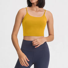 Load image into Gallery viewer, Take your active look from studio to street with this Longline Padded Sports Bra - Mustard Yellow. Featuring thin straps and 13-15 inch / 33-38 cm shortened length, this fitted crop tank top is ideal for low impact activities, be it for workouts, running errands or lounging. This cute camisole kisses your high waisted pants, and is easy to layer. Perfect for low impact exercise like weight training, yoga, cycling, spinning, dancing and more. Complete the look with our High Waist Hidden Pocket Leggings.