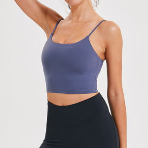 Take your active look from studio to street with this Longline Padded Sports Bra - Navy Blue. Featuring thin straps and 13-15 inch / 33-38 cm shortened length, this fitted crop tank top is ideal for low impact activities, be it for workouts, running errands or lounging. This cute camisole kisses your high waisted pants, and is easy to layer. Perfect for low impact exercise like weight training, yoga, cycling, spinning, dancing and more. Complete the look with our High Waist Hidden Pocket Leggings.