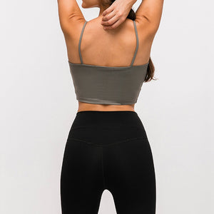 Take your active look from studio to street with this Longline Padded Sports Bra - Olive Green. Featuring thin straps and 13-15 inch / 33-38 cm shortened length, this fitted crop tank top is ideal for low impact activities, be it for workouts, running errands or lounging. This cute camisole kisses your high waisted pants, and is easy to layer. Perfect for low impact exercise like weight training, yoga, cycling, spinning, dancing and more. Complete the look with our High Waist Hidden Pocket Leggings.