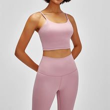 Load image into Gallery viewer, Take your active look from studio to street with this Longline Padded Sports Bra - Pink. Featuring thin straps and 13-15 inch / 33-38 cm shortened length, this fitted crop tank top is ideal for low impact activities, be it for workouts, running errands or lounging. This cute camisole kisses your high waisted pants, and is easy to layer. Perfect for low impact exercise like weight training, yoga, cycling, spinning, dancing and more. Complete the look with our High Waist Hidden Pocket Leggings.