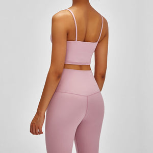 Take your active look from studio to street with this Longline Padded Sports Bra - Pink. Featuring thin straps and 13-15 inch / 33-38 cm shortened length, this fitted crop tank top is ideal for low impact activities, be it for workouts, running errands or lounging. This cute camisole kisses your high waisted pants, and is easy to layer. Perfect for low impact exercise like weight training, yoga, cycling, spinning, dancing and more. Complete the look with our High Waist Hidden Pocket Leggings.