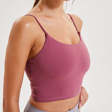 Load image into Gallery viewer, Take your active look from studio to street with this Longline Padded Sports Bra - Rose Red. Featuring thin straps and 13-15 inch / 33-38 cm shortened length, this fitted crop tank top is ideal for low impact activities, be it for workouts, running errands or lounging. This cute camisole kisses your high waisted pants, and is easy to layer. Perfect for low impact exercise like weight training, yoga, cycling, spinning, dancing and more. Complete the look with our High Waist Hidden Pocket Leggings.