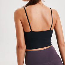 Load image into Gallery viewer, Take your active look from studio to street with this Longline Padded Sports Bra - Black. Featuring thin straps and 13-15 inch / 33-38 cm shortened length, this fitted crop tank top is ideal for low impact activities, be it for workouts, running errands or lounging. This cute camisole kisses your high waisted pants, and is easy to layer. Perfect for low impact exercise like weight training, yoga, cycling, spinning, dancing and more. Complete the look with our High Waist Hidden Pocket Leggings.