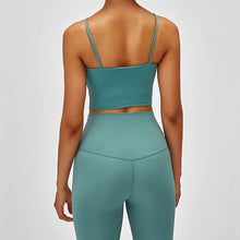 Load image into Gallery viewer, Take your active look from studio to street with this Longline Padded Sports Bra - Teal Green. Featuring thin straps and 13-15 inch / 33-38 cm shortened length, this fitted crop tank top is ideal for low impact activities, be it for workouts, running errands or lounging. This cute camisole kisses your high waisted pants, and is easy to layer. Perfect for low impact exercise like weight training, yoga, cycling, spinning, dancing and more. Complete the look with our High Waist Hidden Pocket Leggings.