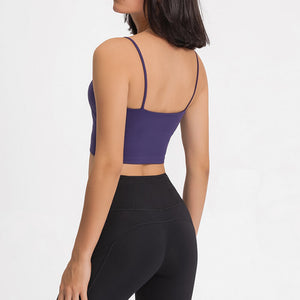 Take your active look from studio to street with this Longline Padded Sports Bra - Violet. Featuring thin straps and 13-15 inch / 33-38 cm shortened length, this fitted crop tank top is ideal for low impact activities, be it for workouts, running errands or lounging. This cute camisole kisses your high waisted pants, and is easy to layer. Perfect for low impact exercise like weight training, yoga, cycling, spinning, dancing and more. Complete the look with our High Waist Hidden Pocket Leggings.
