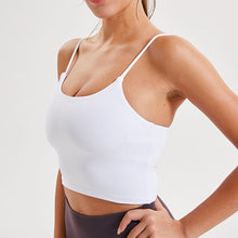 Load image into Gallery viewer, Take your active look from studio to street with this Longline Padded Sports Bra - White. Featuring thin straps and 13-15 inch / 33-38 cm shortened length, this fitted crop tank top is ideal for low impact activities, be it for workouts, running errands or lounging. This cute camisole kisses your high waisted pants, and is easy to layer. Perfect for low impact exercise like weight training, yoga, cycling, spinning, dancing and more. Complete the look with our High Waist Hidden Pocket Leggings.