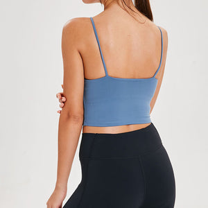 Take your active look from studio to street with this Longline Padded Sports Bra - Blue. Featuring thin straps and 13-15 inch / 33-38 cm shortened length, this fitted crop tank top is ideal for low impact activities, be it for workouts, running errands or lounging. This cute camisole kisses your high waisted pants, and is easy to layer. Perfect for low impact exercise like weight training, yoga, cycling, spinning, dancing and more. Complete the look with our High Waist Hidden Pocket Leggings.