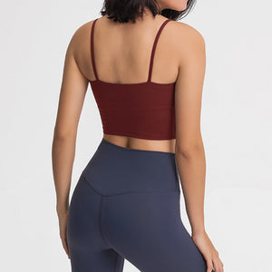 Take your active look from studio to street with this Longline Padded Sports Bra - Burgundy. Featuring thin straps and 13-15 inch / 33-38 cm shortened length, this fitted crop tank top is ideal for low impact activities, be it for workouts, running errands or lounging. This cute camisole kisses your high waisted pants, and is easy to layer. Perfect for low impact exercise like weight training, yoga, cycling, spinning, dancing and more. Complete the look with our High Waist Hidden Pocket Leggings.