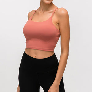 Take your active look from studio to street with this Longline Padded Sports Bra - Coral. Featuring thin straps and 13-15 inch / 33-38 cm shortened length, this fitted crop tank top is ideal for low impact activities, be it for workouts, running errands or lounging. This cute camisole kisses your high waisted pants, and is easy to layer. Perfect for low impact exercise like weight training, yoga, cycling, spinning, dancing and more. Complete the look with our High Waist Hidden Pocket Leggings.