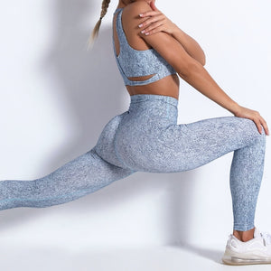 Add some new style to your workout wardrobe with this Hummingbird Marble Print Gym Yoga Set - Sapphire. This patterned gym set comes with a 2-in-1 crop tank top sports bra and a pair of seamless high-rise leggings. Individual items available for mixing and matching. 2-in-1 crop tank top sports bra has a scoop neckline and a racerback second layer. A pair of fitted leggings is high-rise and squat proof. Widened waistband lies flat against your skin. This gym yoga set will make you stand out from the crowd.