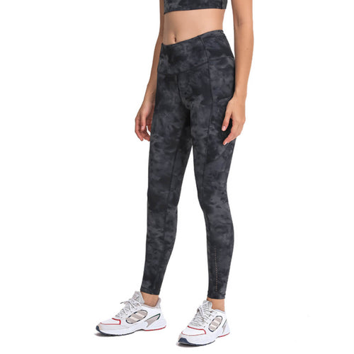 Bring your electronic companion along with these Mid-rise Leggings with Pockets - Tie Dye Charcoal. Featuring mid rise waistband, deep side pockets and reflective details, these fitted workout leggings are perfect for jogging, yoga, weight training, as well as running errands. Deep side pockets can store essentials like a phone, keys, cards etc. Aesthetic seams accentuate body curves. Buttery soft fabric with a brushed feel enables performance even when it's cold.