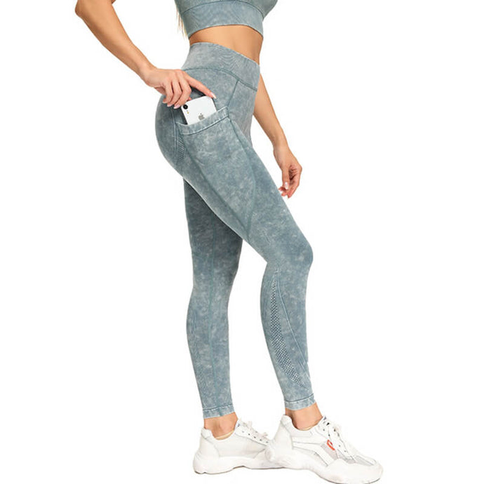 Style a vintage and cool athleisure look with these Mineral Wash Seamless Pocket Leggings in Blue Grey. These non-see-through leggings are mid-rise fitted with ribbed waistband. Deep right side pocket is designed for essentials like a phone. Aesthetic seams and eyelets accentuate body curves and facilitate ventilation. Each pair of leggings is slightly different and has its own unique pattern, which means you can't find the same pair anywhere else! Perfect for workout and post-gym errand running.