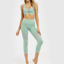 Load image into Gallery viewer, Hummingbird Mint Sports Set containing a Mint Cutout Adjustable Strap Sports Bra with adjustable elastic back straps, front cutout design and a pair of Mint Mesh Cropped Leggings with mesh on the thighs