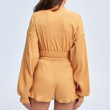 Load image into Gallery viewer, Keep yourself warm and mobile with this Move Free Ribbed Crop Top & Gym Short Set in Pumpkin Spice. Pullover long sleeve sweatshirt features cropped length, dropped shoulders, and elasticated ribbed hem. Matching gym shorts are mid-rise with drawstring. Side pockets can store essentials like a phone or ID. Elasticated ribbed cuffs keep fabric in place. Breathable ribbed cotton fabric empowers freedom of movement. Perfect for OOTD, outer wear pre/post gym or studio, jogging, dancing and more.