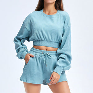 Keep yourself warm and mobile with this Move Free Ribbed Crop Top & Gym Short Set in Ice Blue. Pullover long sleeve sweatshirt features cropped length, dropped shoulders, and elasticated ribbed hem. Matching gym shorts are mid-rise with drawstring. Side pockets can store essentials like a phone or ID. Elasticated ribbed cuffs keep fabric in place. Breathable ribbed cotton fabric empowers freedom of movement. Perfect for OOTD, outer wear pre/post gym or studio, jogging, dancing and more.