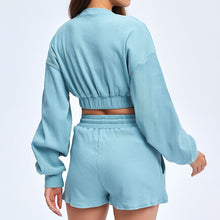 Load image into Gallery viewer, Keep yourself warm and mobile with this Move Free Ribbed Crop Top & Gym Short Set in Ice Blue. Pullover long sleeve sweatshirt features cropped length, dropped shoulders, and elasticated ribbed hem. Matching gym shorts are mid-rise with drawstring. Side pockets can store essentials like a phone or ID. Elasticated ribbed cuffs keep fabric in place. Breathable ribbed cotton fabric empowers freedom of movement. Perfect for OOTD, outer wear pre/post gym or studio, jogging, dancing and more.