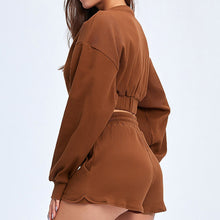 Load image into Gallery viewer, Keep yourself warm and mobile with this Move Free Ribbed Crop Top & Gym Short Set in Copper Brown. Pullover long sleeve sweatshirt features cropped length, dropped shoulders, and elasticated ribbed hem. Matching gym shorts are mid-rise with drawstring. Side pockets can store essentials like a phone or ID. Elasticated ribbed cuffs keep fabric in place. Breathable ribbed cotton fabric empowers freedom of movement. Perfect for OOTD, outer wear pre/post gym or studio, jogging, dancing and more.