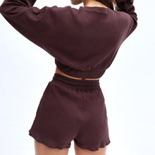 Load image into Gallery viewer, Keep yourself warm and mobile with this Move Free Ribbed Crop Top & Gym Short Set in Burgundy. Pullover long sleeve sweatshirt features cropped length, dropped shoulders, and elasticated ribbed hem. Matching gym shorts are mid-rise with drawstring. Side pockets can store essentials like a phone or ID. Elasticated ribbed cuffs keep fabric in place. Breathable ribbed cotton fabric empowers freedom of movement. Perfect for OOTD, outer wear pre/post gym or studio, jogging, dancing and more.