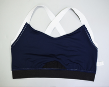 Load image into Gallery viewer, Hummingbird Navy Sports high rise Bra with a silver metallic band and elastic shoulder straps.