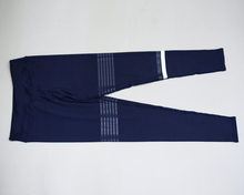 Load image into Gallery viewer, Hummingbird Navy Striped Cropped Leggings with the asymmetric blue and white stripes. Perfect for workout and yoga