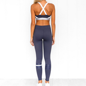 Hummingbird Navy Striped Cropped Leggings with the asymmetric blue and white stripes. Perfect for workout and yoga