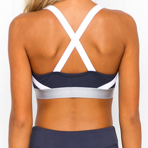 Hummingbird Navy Sports Set containing a Navy Sports Bra with a silver metallic band and elastic shoulder straps and a pair of Navy Striped Cropped Leggings with asymmetric blue and white stripes