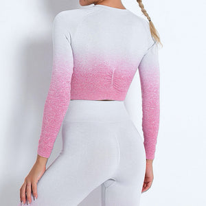 Demonstrate your holistic transition with this Ombre Seamless Crop Top & Leggings Set - Pink. This matching workout set includes a pair of leggings and a crop top. Individual items are available for mixing and matching. Crop top features raglan long sleeves and flattering ruched details on center back. A pair of leggings are high-waist fitted with ribbed waistband. Made with dip-dye techniques. Each set is slightly different. Perfect for all sorts of exercise and post-gym errand running.