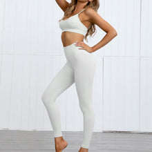Load image into Gallery viewer, Hummingbird Pastel Seamless Leggings Set B - Cream comes with a crop tank top sports bra and a pair of high waisted leggings. Individual items are available for mixing and matching. Crop tank top sports bra is low cut and has adjustable spaghetti straps. A pair of leggings are high-rise with widened waistband that lies flat against your skin. Seamless fabrication reduces chafing during workout. This Pastel Seamless Leggings Set is a handy gym set for warm weather. Perfect for low impact workouts.