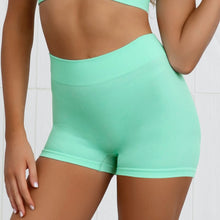 Load image into Gallery viewer, Hummingbird Pastel Seamless Biker Shorts Set A - Mint comes with a crop tank top sports bra and a pair of mid-rise biker shorts. Individual items are available for mixing and matching. Crop tank top sports bra is low cut and has adjustable spaghetti straps. A pair of fitted biker shorts is mid-rise and squat proof. This Pastel Seamless Biker Shorts Set is a handy gym set for warm weather, and can be worn alone or with a loose tank top. Perfect for low impact workouts.