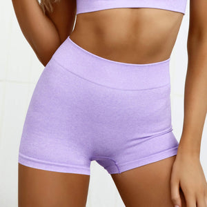 Hummingbird Pastel Seamless Biker Shorts Set A - Lilac comes with a crop tank top sports bra and a pair of mid-rise biker shorts. Individual items are available for mixing and matching. Crop tank top sports bra is low cut and has adjustable spaghetti straps. A pair of fitted biker shorts is mid-rise and squat proof. This Pastel Seamless Biker Shorts Set is a handy gym set for warm weather, and can be worn alone or with a loose tank top. Perfect for low impact workouts.