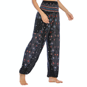 Empower your energy flow and blood circulation during yoga practice with these Hummingbird Peacock Smocked Waist Yoga Harem Pants - Black. Featuring long peacock train feathers and colorful eyespots, these loose yoga pants are the must-have companion for your yoga journey, be it for asanas, pranayama, or meditation. Fit most body types with high rise smocked waist and elastic cuffed hems. Handmade by Thai people with breathable, soft, lightweight and quick dry fabric and natural dyeing techniques.
