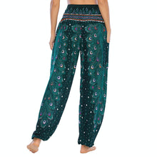 Load image into Gallery viewer, Empower your energy flow and blood circulation during yoga practice with these Hummingbird Peacock Smocked Waist Yoga Harem Pants - Teal Green. Featuring long peacock train feathers and colorful eyespots, these loose yoga pants are the must-have companion for your yoga journey, be it for asanas, pranayama, or meditation. Fit most body types with high rise smocked waist and elastic cuffed hems. Handmade by Thai people with breathable, soft, lightweight and quick dry fabric and natural dyeing techniques.