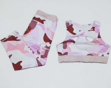 Load image into Gallery viewer, Hummingbird Pink Camo Sports Set containing a cutout racerback top and a pair of cropped leggings with outside pockets. Made of breathable and wicking fabric that's comfortable to wear