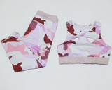 Hummingbird Pink Camo Sports Set containing a cutout racerback top and a pair of cropped leggings with outside pockets. Made of breathable and wicking fabric that's comfortable to wear