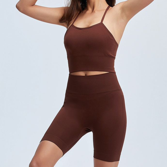 Get hyped for your workout session in this Power Up Longline Sports Bra & Bike Shorts Set in Russet. This seamless matching workout set comes with a padded sports bra and a pair of biker shorts. Padded sports bra features longline silhouette and crisscross shoulder straps. Biker shorts are mid- to high-rise fitted with seamless front. This form-fitting 2 piece workout set is perfect for all sorts of activities from gym to street.
