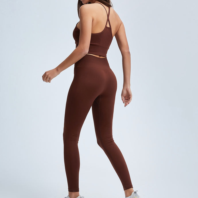 Get hyped for your workout session in this Power Up Longline Sports Bra & Leggings Set in Russet. This seamless matching workout set comes with a padded sports bra and a pair of leggings/biker shorts. Padded sports bra features longline silhouette and crisscross shoulder straps. Leggings are mid- to high-rise fitted with seamless front. This form-fitting 2 piece workout set is perfect for all sorts of activities from gym to street.