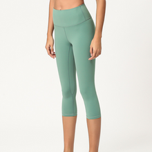 Load image into Gallery viewer, Hummingbird Pastel Workout Yoga Cropped Leggings With Pocket made of peached fabric, which is smooth, breathable and sweat absorbent