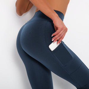 With this Ribbed Pocket Leggings & Sports Bra Set - Sapphire Blue, incorporating activewear into your everyday wardrobe makes easy. This matching workout set comes with a pair of leggings with pockets and a racerback sports bra. Individual items are available for mixing and matching. Leggings are mid-rise fitted with 2 side pockets for essentials like a phone or an ID. Racerback sport bra features a special semi-open back silhouette that helps you move your body with ease and promotes ventilation.