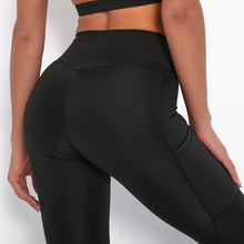 Load image into Gallery viewer, With this Ribbed Pocket Leggings & Sports Bra Set - Black, incorporating activewear into your everyday wardrobe makes easy. This matching workout set comes with a pair of leggings with pockets and a racerback sports bra. Individual items are available for mixing and matching. Leggings are mid-rise fitted with 2 side pockets for essentials like a phone or an ID. Racerback sport bra features a special semi-open back silhouette that helps you move your body with ease and promotes ventilation.