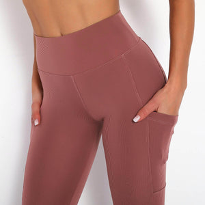 With this Ribbed Pocket Leggings & Sports Bra Set - Warmred, incorporating activewear into your everyday wardrobe makes easy. This matching workout set comes with a pair of leggings with pockets and a racerback sports bra. Individual items are available for mixing and matching. Leggings are mid-rise fitted with 2 side pockets for essentials like a phone or an ID. Racerback sport bra features a special semi-open back silhouette that helps you move your body with ease and promotes ventilation.