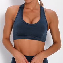 Load image into Gallery viewer, With this Ribbed Pocket Leggings & Sports Bra Set - Sapphire Blue, incorporating activewear into your everyday wardrobe makes easy. This matching workout set comes with a pair of leggings with pockets and a racerback sports bra. Individual items are available for mixing and matching. Leggings are mid-rise fitted with 2 side pockets for essentials like a phone or an ID. Racerback sport bra features a special semi-open back silhouette that helps you move your body with ease and promotes ventilation.