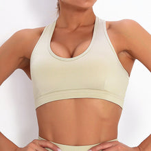 Load image into Gallery viewer, With this Ribbed Pocket Leggings & Sports Bra Set - Beige, incorporating activewear into your everyday wardrobe makes easy. This matching workout set comes with a pair of leggings with pockets and a racerback sports bra. Individual items are available for mixing and matching. Leggings are mid-rise fitted with 2 side pockets for essentials like a phone or an ID. Racerback sport bra features a special semi-open back silhouette that helps you move your body with ease and promotes ventilation.